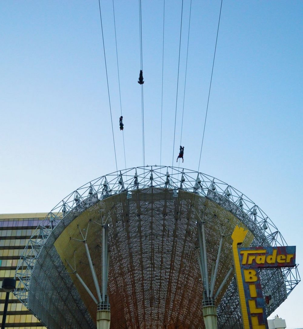 Zoomline riders soar over FSE from Slotzilla at Fremont Street Experience Las Vegas